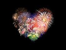 Feux d'artifice colorés en forme de coeur Photo stock