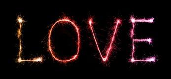 Feux d'artifice d'étincelle d'amour célébrant la nuit Images libres de droits
