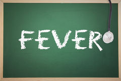 A Fever against chalkboard. The word fever and stethoscope against chalkboard Royalty Free Stock Photo