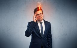 Sick businessman with burning head concept stock photo