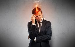 Sick businessman with burning head concept stock images