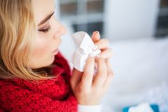 Fever And Cold. Portrait Of Beautiful Woman Caught Flu, Having Headache And High Temperature. Closeup Of Ill Girl. Covered In Blanket, Feeling Sick Holding stock photo