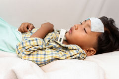 Fever. A little boy who has fever.focus at a temperature Stock Photos