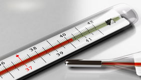 Fever. Thermometer over grey background. Image for illustration of fever or high temperature Stock Photo