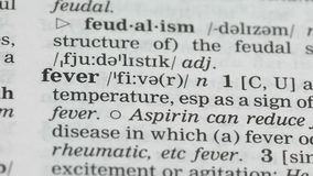 Fever word definition on english vocabulary page, epidemics outburst vaccination. Stock footage stock video