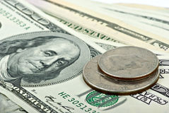 Few 100$ banknotes and two coins Stock Photography
