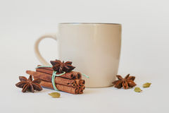 A few anise stars, cassia cinnamon sticks, dried orange rings and fruit tea on the tablecloth royalty free stock photography