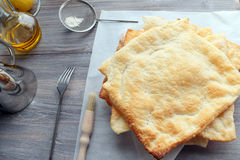 A few baked pie layers from puff paste on the wooden table, sieve, flour, fork, oil Royalty Free Stock Photos