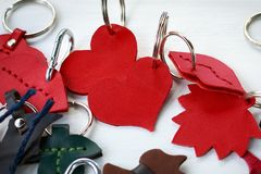 A few beautiful leather keychains in shape of heart handmade.  Stock Image