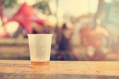 Few beer in the plastic cup on wooden table. A sunny day Royalty Free Stock Photos