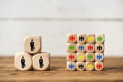 Few big clients vs many small clients. Symbolized with cubes stock images