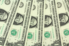 A few bills into one US dollar background Royalty Free Stock Photography