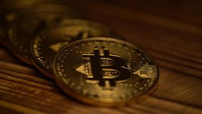 Few bitcoins are lying on the table. Close up