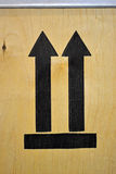 Few black arrows on wooden surface, luggage, Royalty Free Stock Photo
