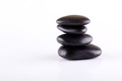 Few black lava stones stacked at each other Royalty Free Stock Images