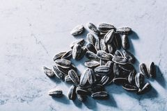 A few black sunflower seeds. Fit snack. Stock Photo