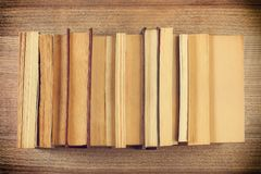 A few books on a wooden desk. A few books side by side Stock Image
