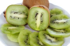 Few brown fresh kiwi fruit, slices Royalty Free Stock Photography
