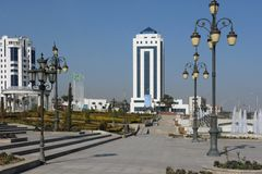 Few buildings standing in front of the square. Ashkhabad. Turkmenistan Stock Image
