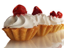 A few cakes. Some cake with cream and strawberries isolated on white background Stock Photos