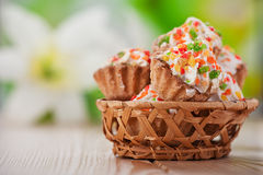 Few cakes in wicker basket Royalty Free Stock Photo