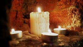 Candles burn in the dark. A few candles burn in the dark stock video