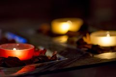 Romance with candles. Few candles in the table with romantic atmosphere Stock Images