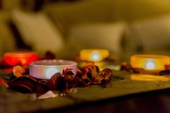 Some romance with candles on a table. Few candles in the table with romantic atmosphere, valentine`s day royalty free stock photos