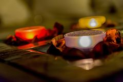 Some romance with candles on a table. Few candles in the table with romantic atmosphere, valentine`s day royalty free stock photo