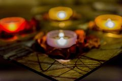 Some romance with candles on a table. Few candles in the table with romantic atmosphere, valentine`s day Stock Images