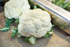 Few cauliflowers on  counter market Stock Photo
