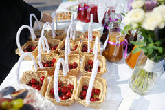 A few cherry baskets on an event party Royalty Free Stock Photography