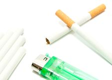 Few cigarettes and plastic lighter Royalty Free Stock Photography