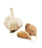 Few cloves of garlic. Isolated on a white background Royalty Free Stock Photo