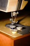 Few coils with threads on sewing machine Royalty Free Stock Photography