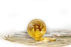 Few coins of bitcoin on dollar bills as a symbol of a new curren Stock Photography