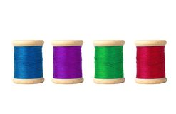 Few color bobbins isolated on white Royalty Free Stock Photography