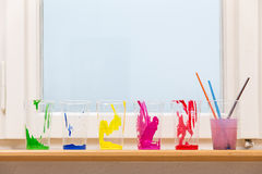 A few color cups on the windowsill Stock Photography