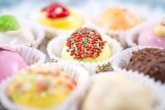 Petits fours. A few colored petits fours cakes Stock Photos