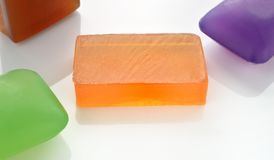 Few colorful glycerin soaps on white. Royalty Free Stock Images
