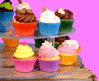 Few colourful cupcakes on street market. Royalty Free Stock Image