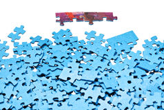 Few connected pieces near of separated puzzles Stock Photo