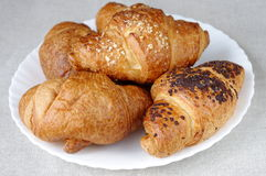 Few croissants on a plate Stock Photos