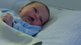 Few days old newborn baby on bed in hospital. This is few days old newborn baby in hospital stock footage