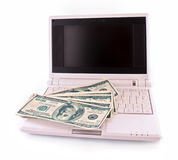 Few dollar banknotes on laptop Stock Image
