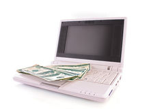 Few dollar banknotes on laptop isolated Stock Photos