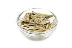 A few dried anchovies in a glass cup Stock Photo