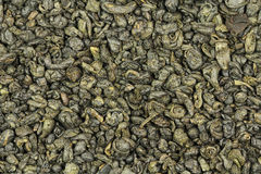 A few dried green tea leavesbackground Royalty Free Stock Images