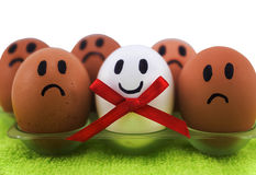 A few eggs with facial expressions Stock Photography
