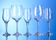 Few empty wine glasses on blue Royalty Free Stock Image